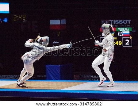 MOSCOW, RUSSIA - MAY 31 2015: O. Kharlan (L) and S. Velikaya (R) fencing on final during the World  fencing Grand Prix Moscow Saber in Luzhniki sport palace - stock photo