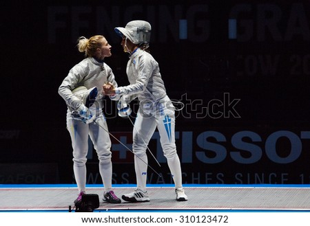 MOSCOW, RUSSIA - MAY 31 2015: O. Kharlan (L) and V. Vougiouka (R) hugging on the World  fencing Grand Prix Moscow Saber in Luzhniki sport palace - stock photo
