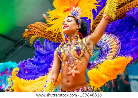 MOSCOW, RUSSIA - 18 MAY: Participants of annual carnival in Moscow in Ermitage Garden - latin dancer. Moscow, 18 may, 2013