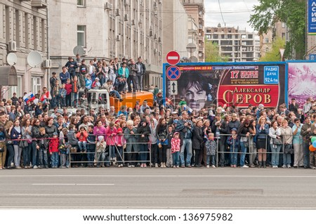MOSCOW/RUSSIA - MAY 9: People on Tverskaya street side wait for motorcade on display during parade festivities devoted to anniversary of Victory Day on May 9, 2011 in Moscow.