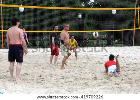 MOSCOW, RUSSIA - MAY 31, 2015: Playing beach volleyball in the Central Recreation Park - stock photo