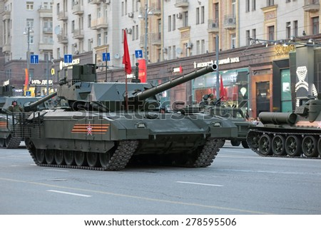 MOSCOW, RUSSIA- MAY 04, 2015: Rehearsal celebration of the 70th anniversary of the Victory Day (WWII). Military equipment on Tverskaya street prepares to travel to the Red Square. The T-14 Armata tank - stock photo