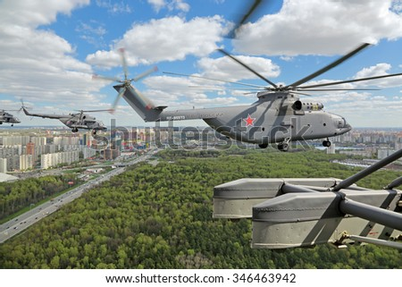 MOSCOW, RUSSIA - MAY 05, 2015: Rehearsal of parade of the 70th anniversary of the Victory Day (WWII). Flight of aircraft over the city, military helicopters flies to Moscow in the town of Khimki - stock photo