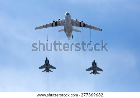 MOSCOW, RUSSIA - MAY 9, 2015:Russian Air Force IL-78 air-to-air refueling tanker demonstrates in-flight refueling of Mikoyan MiG-31 strategic bomber during for Victory Day military parade - stock photo