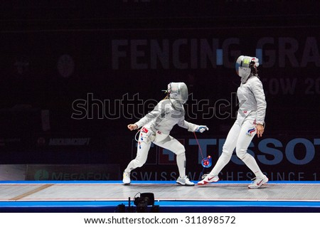 MOSCOW, RUSSIA - MAY 31 2015: S. Velikaya versus J. Kim on the World  fencing Grand Prix Moscow Saber in Luzhniki sport palace - stock photo