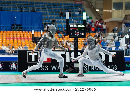 MOSCOW, RUSSIA - MAY 31 2015: Sofia Velikaya and Sara Balzer fight on the World  fencing Grand Prix Moscow Saber in Luzhniki sport palace - stock photo