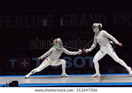 MOSCOW, RUSSIA - MAY 31 2015: Sofia Velikaya (R) versus Jung Kim (L) on the World  fencing Grand Prix Moscow Saber in Luzhniki sport palace - stock photo