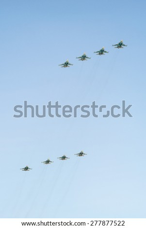 MOSCOW/RUSSIA - MAY 7: 8 Sukhoi Su-34 (Fullback) twin-seat fighter-bomber aircrafts on rehearsal of parade devoted to 70-th Victory Day aniversary on May 7, 2015 in Moscow. - stock photo