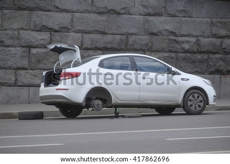 Moscow, Russia - May, 6, 2016: the broken car costs without wheel in the center of Moscow, Russia - stock photo