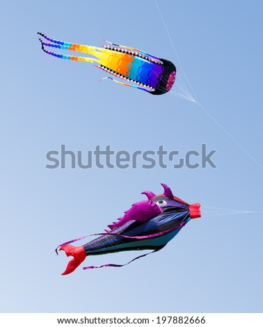 """MOSCOW, RUSSIA - MAY 31: The great fish-like and octopus-like kites at the """"Harlequin sky"""" kites festival on MAY 31, 2014 in Moscow, Russia.  - stock photo"""