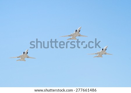 MOSCOW/RUSSIA - MAY 7: 3 Tupolev Tu-22M3 (Backfire) supersonic swing-wing long-range strategic and maritime strike bombers on rehearsal of parade devoted to Victory Day on May 7, 2015 in Moscow. - stock photo