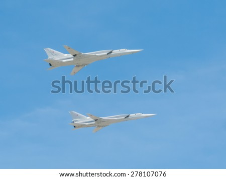 MOSCOW/RUSSIA - MAY 7: 2 Tupolev Tu-22M3 (Backfire) supersonic swing-wing long-range strategic and maritime strike bombers fly on parade devoted to Victory Day aniversary on May 7, 2015 in Moscow. - stock photo