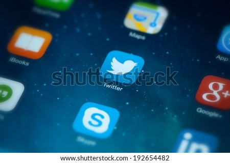 "MOSCOW, RUSSIA - MAY 09, 2014: Twitter icon on screen. Twitter is an online microblogging service that enables users to send and read ""tweets"", which are text messages limited to 140 characters. - stock photo"