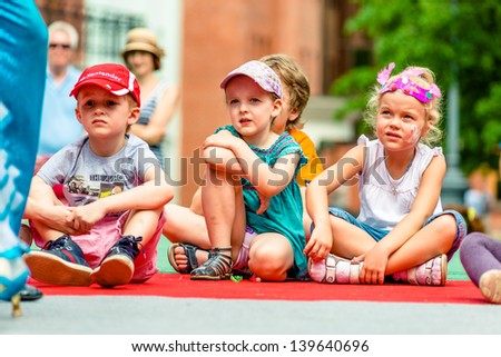 MOSCOW, RUSSIA - 18 MAY: Unidentified children watching annual carnival in Moscow in Ermitage Garden right on stage. Moscow, 18 may, 2013