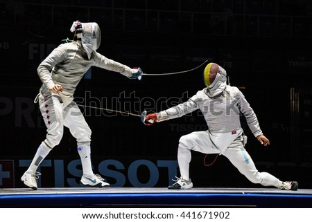 Moscow, Russia - May 30, 2015: Unidentified professional fencers in the finals of the men's individual event at the 2015 Moscow Sabre international fencing tournament.