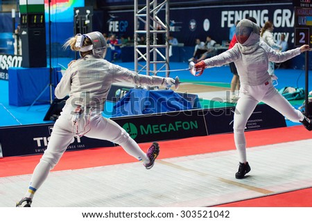 MOSCOW, RUSSIA - MAY 31 2015: Victoria Kovaleva and Olga Kharlan fencing on the World  fencing Grand Prix Moscow Saber in Luzhniki sport palace - stock photo