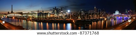 Moscow, Russia. Night. Panoramic view from the embankment of the Moskva River in the Kievsky train station, international business centre and bridges - stock photo