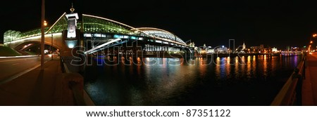 Moscow, Russia. Night. Panoramic view from the embankment of the Moskva River. Pedestrian bridge Bogdan Khmelnitsky - stock photo