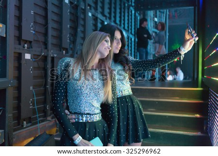 MOSCOW, RUSSIA - NOVEMBER 15, 2014: Propaganda Group makes selfie before going on stage at a party Diskach 90th in a club Space Moscow. Propaganda - Russian female pop group, founded in 2001 - stock photo