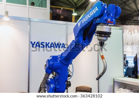 "Moscow, Russia, 20 November 2015: The 3rd International Exhibition of Robotics and advanced technologies ""Robotics Expo"" in Moscow. focus on top of the manipulator - stock photo"