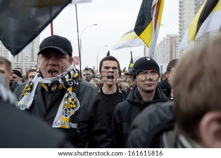 """MOSCOW, RUSSIA - NOVEMBER 4: Unidentified Russian nationalists shout Anti-Islam slogans during annual """"Russian March"""" in Moscow, Russia on November 4, 2013. Nationalism becomes popular among Russians. - stock photo"""
