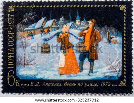 Moscow, Russia - October 3, 2015: A stamp printed in USSR shows Russian man and women, series folk arts, circa 1977 - stock photo