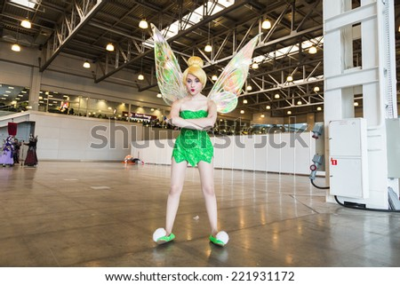 MOSCOW, RUSSIA, October 4: Comic Con attendee poses in the costume Fairy during Comic Con 2014 at The Crocus Center on October 4, 2014 in Moscow, Russia. - stock photo