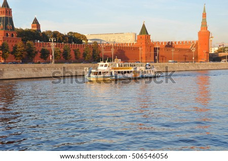 "MOSCOW, RUSSIA - OCTOBER 16, 2015: Pleasure boat ""Moscow-64"" at the walls of the Moscow Kremlin.  Pleasure boat ""Moscow-64"" was built in 1978. Project R-51E. Number of passengers - up to 160 people"