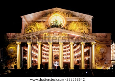 "MOSCOW, RUSSIA - OCTOBER 13, 2014: State Academic Bolshoi Theatre Opera and Ballet illuminated for free open air international festival ""Circle of light"", Moscow, October 13, 2014.  - stock photo"