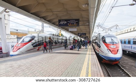 MOSCOW, RUSSIA, on AUGUST 19, 2015. Leningrad station. Two modern high-speed trains Sapsan near a platform expect departure to St. Petersburg