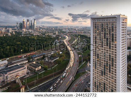 MOSCOW, RUSSIA - SEP 16, 2014: House on Begovaya with traffic on The Third Ring Road, railway, construction of business center - stock photo