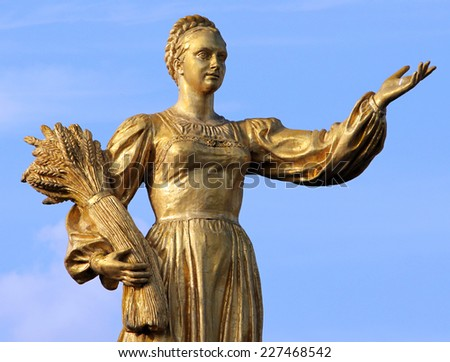 MOSCOW, RUSSIA - SEPT 20, 2014: Woman symbolizing Russia - part of the fountain Friendship of Nations (1954), All Russian Exhibition Center - stock photo