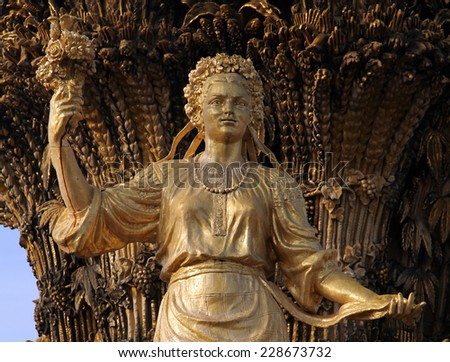 MOSCOW, RUSSIA - SEPT 20, 2014: Woman symbolizing Ukraine - part of the fountain Friendship of Nations (1954), All Russian Exhibition Center - stock photo