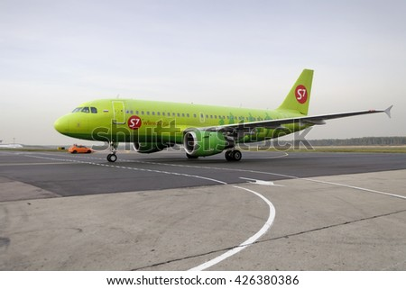 MOSCOW, RUSSIA - SEPTEMBER 26, 2014: S7 airlines Airbus A319. Plane makes taxiing on taxiway Domodedovo International Airport. - stock photo