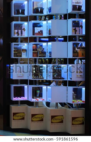Moscow, Russia - September 14, 2016. showcases at the exhibition in the semi-darkness with illumination of shelves with exclusive chocolate products