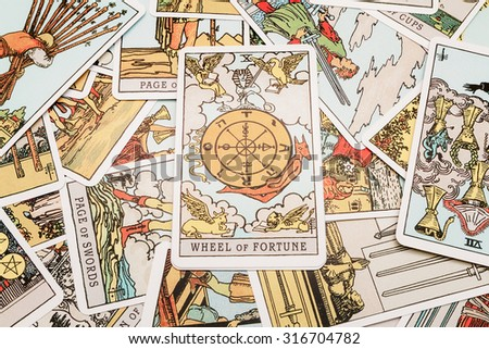 Moscow, Russia-September 7, 2015:Tarot cards Tarot, the wheel of fortune card in the foreground.
