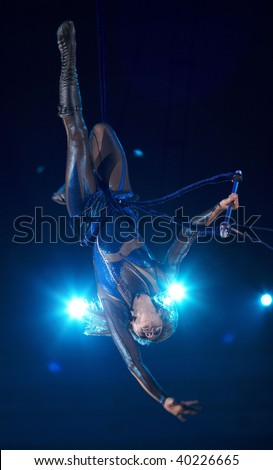 MOSCOW, RUSSIA - SEPTEMBER 03: The unknown gymnast carries out show at Moscow International Circus Festival on September 03, 2009 in Moscow, Russia.