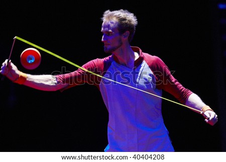 MOSCOW, RUSSIA - SEPTEMBER 03: The unknown juggler carries out show with tops at Moscow International Circus Festival on September 03, 2009 in Moscow, Russia.