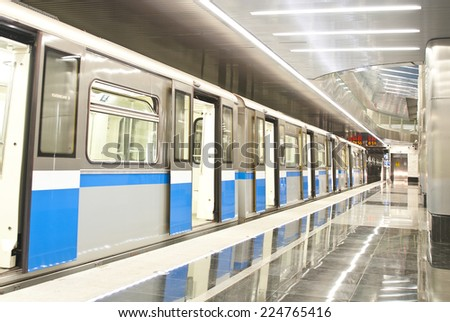 MOSCOW, RUSSIA - SEPTEMBER 26, 2014: Train at platform in Metro station Delovoy Center in Moscow, Russia. Station Delovoy Center was opened 31 January 2014 - stock photo