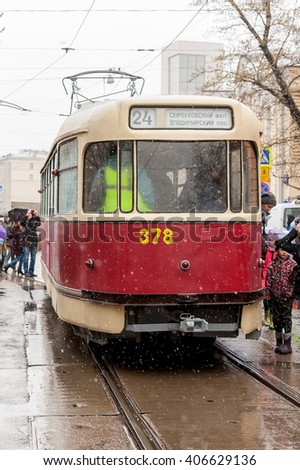 MOSCOW, RUSSIAN FEDERATION - APRIL 16: Vintage trams available again to the public. Rain is not obstacle for the people on the fest of trams. April 16, 2016 in Chistoprudny boulevard, Moscow, Russia .
