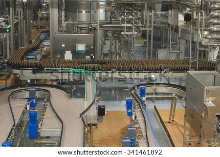 Moscow, Russian Federation - March 07, 2015: Plastic water bottles on conveyor or water bottling machine - stock photo