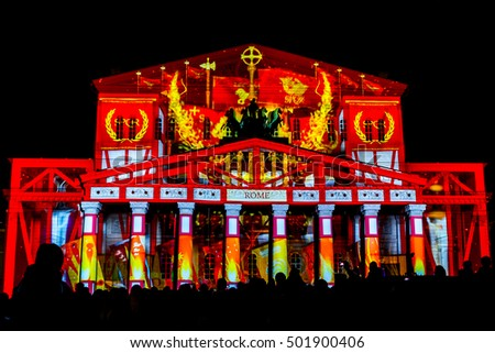 "MOSCOW, RUSSIAN FEDERATION - SEPTEMBER 24, 2016: International festival ""Circle of light"". Light show on the facade of building of the Bolshoi (Large) Theater.  Theater passage."