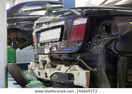 MOSCOW - SEP 21: Two cars is in the repair on car repair shop Avtostandart on September 21, 2012 in Moscow, Russia. - stock photo