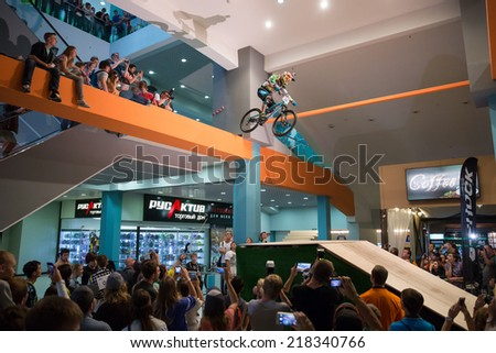 MOSCOW  SEPTEMBER 13: biker on mountainbike jumping at DownMall contest, September 13, 2014 in Moscow, Russia - stock photo