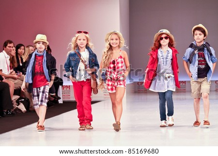 MOSCOW - SEPTEMBER 7: Mayoral clothing collection at the international exhibition of  the fashion industry, Collection Premiere Moscow, CPM on September 7, 2011 in Moscow. Unidentified children - stock photo