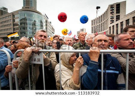 MOSCOW - 15 SEPTEMBER: Opposition activists and supporters take part in an anti-Putin protest on September 15, 2012 in Moscow. In the background: color balloons with the words Freedom to Pussy Riot. - stock photo