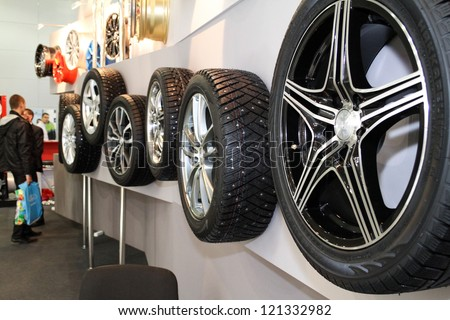 MOSCOW-SEPTEMBER 1: Stack of car wheels continental at the international exhibition of  the automobile industry Moscow international automobile salon MIAS on September 1, 2012 in Moscow - stock photo