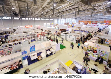MOSCOW - SEPTEMBER 8: Stands of companies on Moscow International book exhibition and fair in VVC, on September 8, 2012 in Moscow, Russia. - stock photo