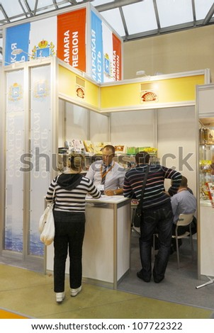 MOSCOW-SEPTEMBER 13:The stand of the Russian confectionery products company SAMARA CONFECTIONER at International Food & Drinks Exhibition on September 13, 2011 in Moscow - stock photo