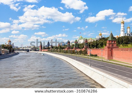 Moscow skyline - Kremlin embankment along Moskva River and Kremlin Cathedrals in Moscow in sunny summer day - stock photo